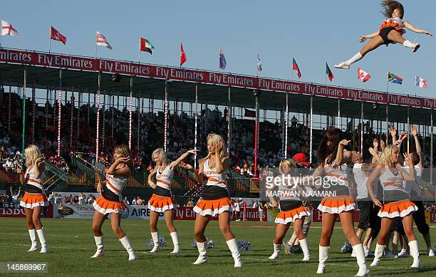 Cheerleaders dance at halftime during the Women's Sevens Challenge Cup semifinal match between Australia and England in the Gulf emirate of Dubai on...
