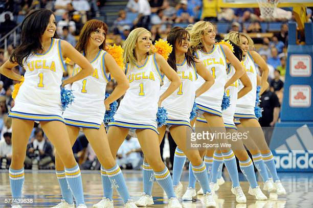 Cheerleaders dance during a college basketball game between the Stanford Cardinals and the UCLA Bruins played at Pauley Pavilion in Los Angeles CA