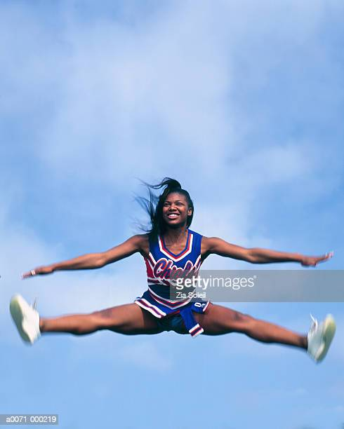 cheerleaders doing splits - doing the splits stock pictures, royalty-free photos & images