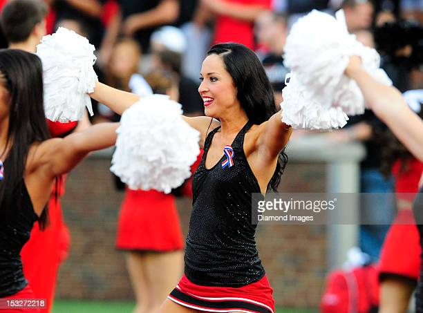 Cheerleaders for the Cincinnati Bearcats cheer on the field before a game between the Cincinnati Bearcats and Delaware State Hornets at Nippert...