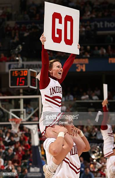 Cheerleaders for the Indiana Hoosiers support their team against the Minnesota Golden Gophers during the Big Ten Men's Basketball Tournament at...