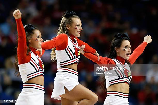 Cheerleaders for the Louisville Cardinals perform during the second round of the 2013 NCAA Men's Basketball Tournament at the Rupp Arena on March 21,...