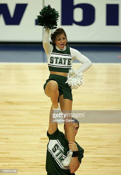 Cheerleaders for the Michigan State Spartans support their team against the Northwestern Wildcats during Day 1 of the Big Ten Men's Basketball...