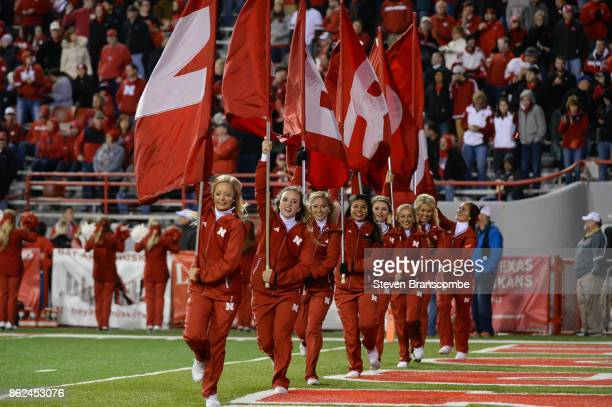 Cheerleaders for the Nebraska Cornhuskers celebrate a score against the Ohio State Buckeyes at Memorial Stadium on October 14 2017 in Lincoln Nebraska