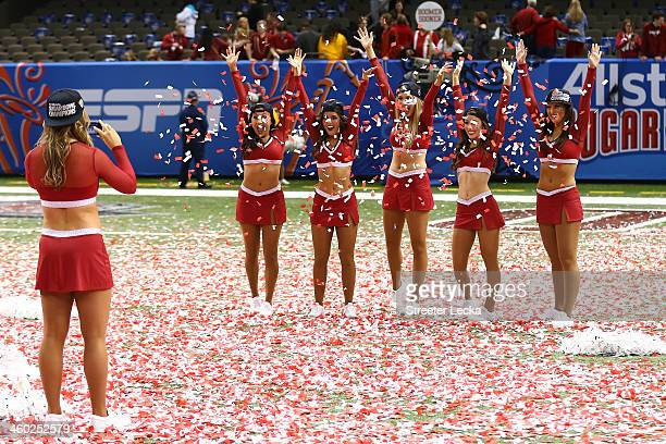 Cheerleaders for the Oklahoma Sooners celebrate after defeating the Alabama Crimson Tide during the Allstate Sugar Bowl at the MercedesBenz Superdome...