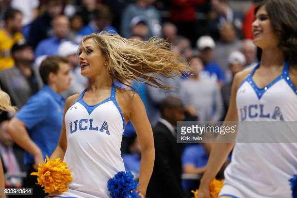 Cheerleaders for the UCLA Bruins dance during a timeout in the game between the UCLA Bruins and the St Bonaventure Bonnies at UD Arena on March 13...