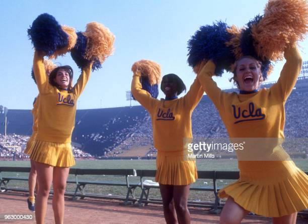 Cheerleaders for the University of California Los Angeles Bruins celebrate with their pom-poms during an NCAA game circa 1970's at the Los Angeles...