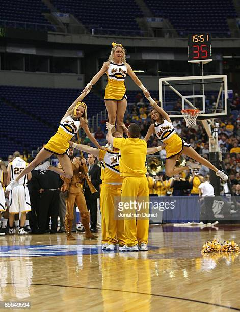Cheerleaders for the West Virginia Moutaineers perform against the Dayton Flyers during the first round of the NCAA Division I Men's Basketball...