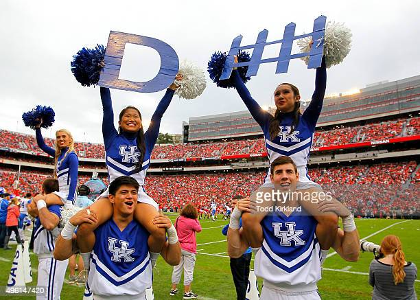 Cheerleaders from the Kentucky Wildcats perform in the third quarter of the game against the Georgia Bulldogs on November 7 2015 at Sanford Stadium...