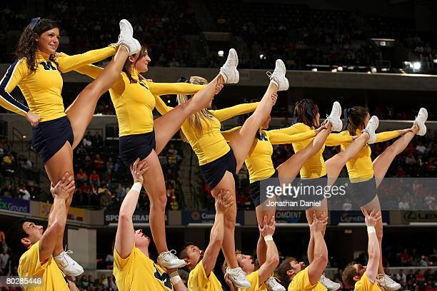Cheerleaders from the Michigan Wolverines perform against the Wisconsin Badgers during the Big Ten Men's Basketball Tournament at Conseco Fieldhouse...