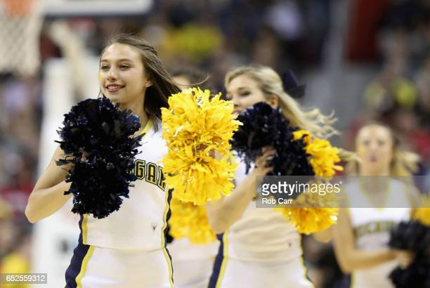 Cheerleaders from the Michigan Wolverines perform during a timeout of the Wolverines and Wisconsin Badgers game during the Big Ten Basketball...