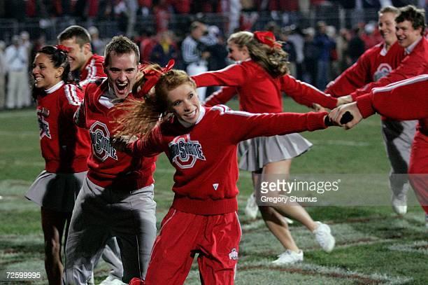 Cheerleaders from the Ohio State Buckeyes celebrate against the Michigan Wolverines November 18 2006 at Ohio Stadium in Columbus Ohio Ohio State won...