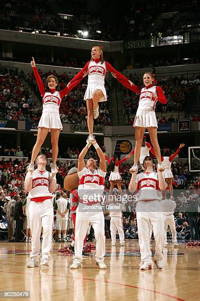 Cheerleaders from the Ohio State Buckeyes perform against the Michigan State Spartans during the Big Ten Men's Basketball Tournament at Conseco...