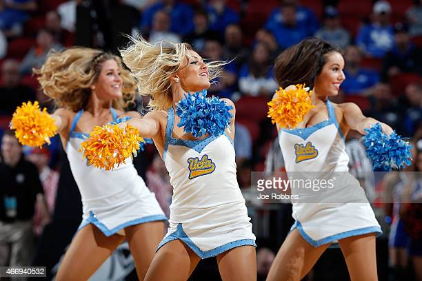 Cheerleaders from the UCLA Bruins performs during the second round of the 2015 NCAA Men's Basketball Tournamenat at the KFC YUM Center on March 19...