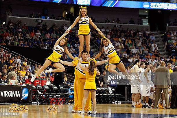 Cheerleaders from the West Virginia Mountaineers perofrm against the Clemson Tigers during the second round of the 2011 NCAA men's basketball...