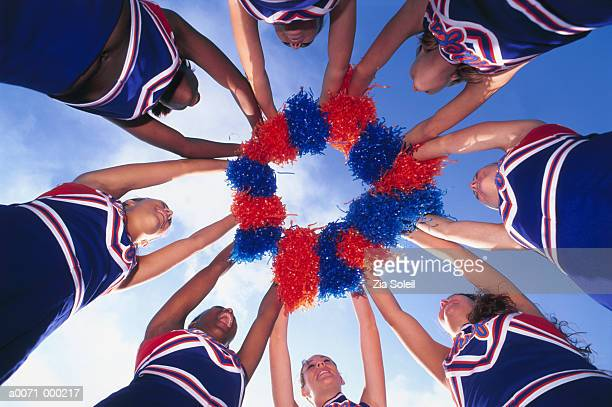 cheerleaders holding pom-poms - cheerleader stock photos and pictures