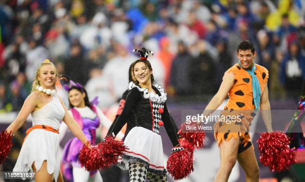 Cheerleaders in costume perform as the New England Patriots play against the Cleveland Browns at Gillette Stadium on October 27 2019 in Foxborough...