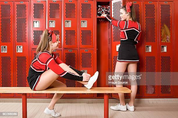 cheerleaders in locker room - teen cheerleader stock photos and pictures