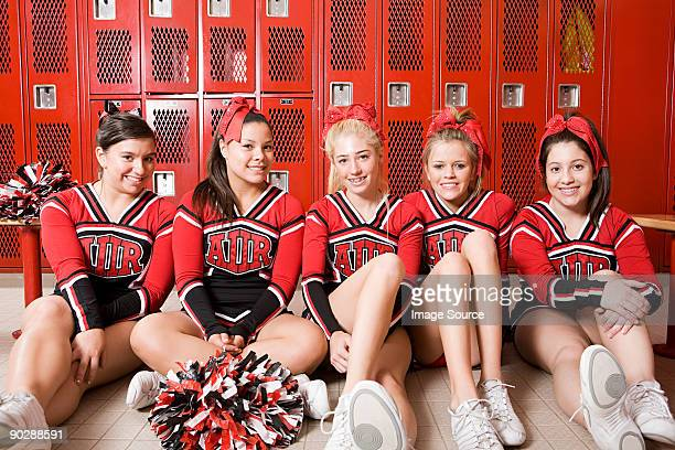 cheerleaders in locker room - black cheerleaders stock photos and pictures