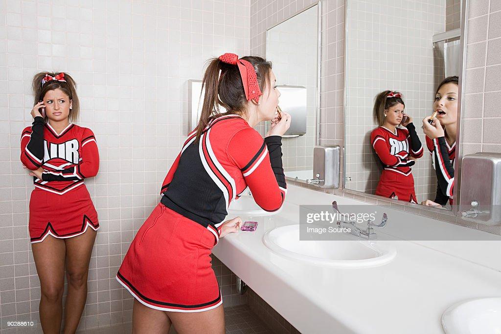 Cheerleaders in restroom : Stock Photo