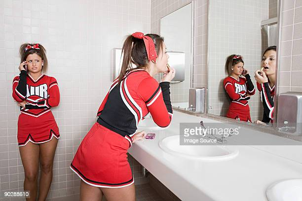 cheerleaders in restroom - girl in mirror stock-fotos und bilder