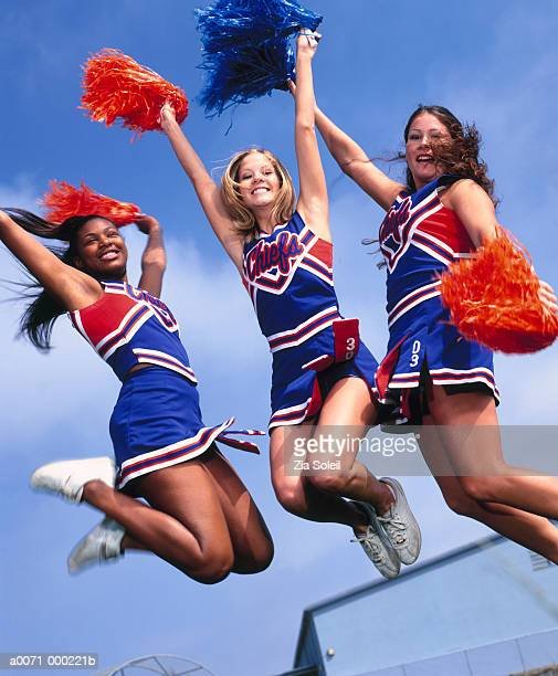 cheerleaders jumping - black cheerleaders stock photos and pictures