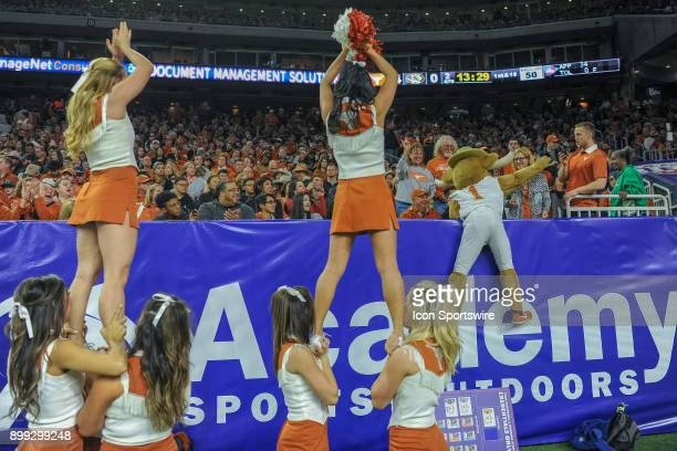 UT cheerleaders mascot and nearby fans sing happy birthday during the Texas Bowl game between the Texas Longhorns and the Missouri Tigers on December...