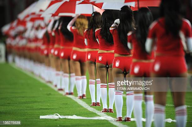 Cheerleaders of Colombia's Independiente Santa Fe stand in the field before the Copa Sudamericana quarterfinal football match against Argentina's...