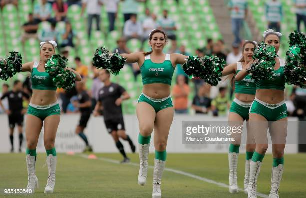 Cheerleaders of Santos cheer for their team prior to the quarter finals second leg match between Santos Laguna and Tigres UANL as part of the Torneo...