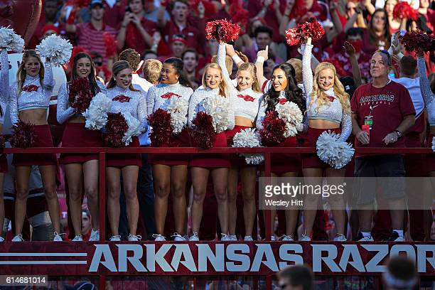 Cheerleaders of the Arkansas Razorbacks get a ride onto the field before a game against the the Alabama Crimson Tide at Razorback Stadium on October...