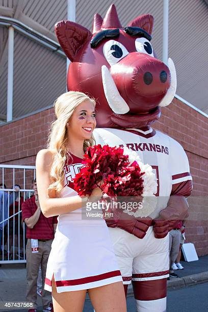 Cheerleaders of the Arkansas Razorbacks greet players during the walk into the stadium before a game against the Georgia Bulldogs at War Memorial...