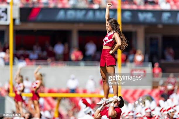 Cheerleaders of the Arkansas Razorbacks perform before a game against the Eastern Illinois Panthers at Razorback Stadium on September 1 2018 in...