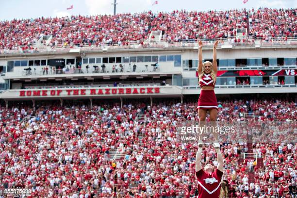 Cheerleaders of the Arkansas Razorbacks perform before a game against the TCU Horned Frogs at Donald W. Reynolds Razorback Stadium on September 9,...