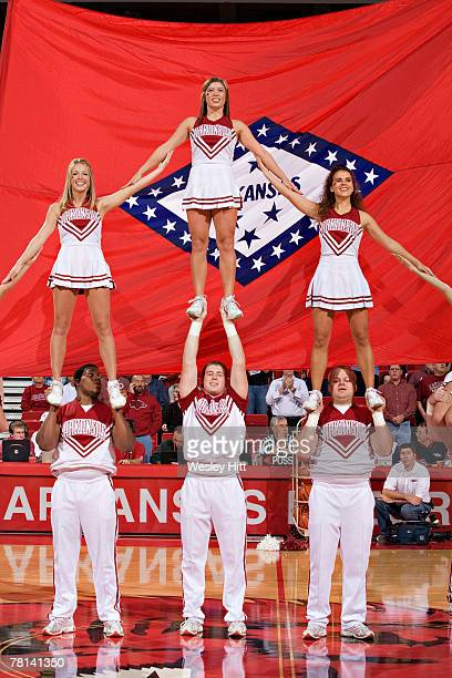 Cheerleaders of the Arkansas Razorbacks perform during their game against the Missouri Tigers at Bud Walton Arena on November 28, 2007 in...