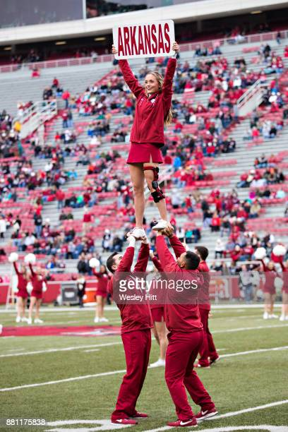 Cheerleaders of the Arkansas Razorbacks warming up before a game against the Mississippi State Bulldogs at Razorback Stadium on November 18, 2017 in...