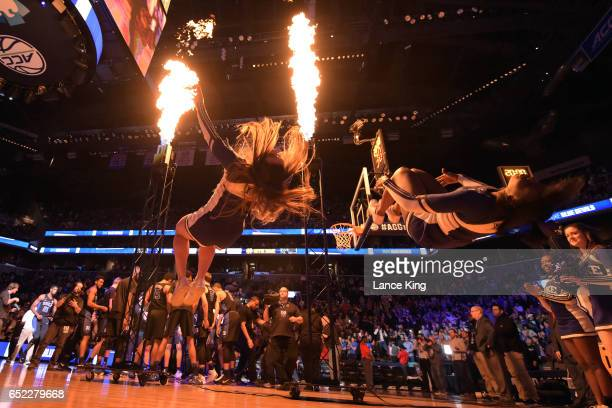 Cheerleaders of the Duke Blue Devils perform as fire lights the court prior to their game against the Notre Dame Fighting Irish during the ACC...
