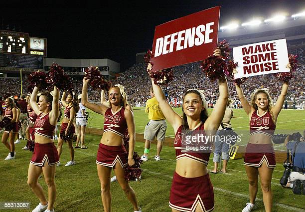 Cheerleaders of the Florida State Seminoles get the crowd to back their team against the Miami Hurricanes at Doak Campbell Stadium on September 5,...