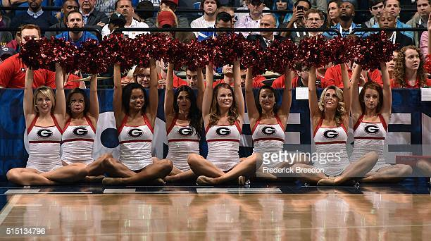 Cheerleaders of the Georgia Bulldogs cheer during the first half of and SEC Basketball Tournament Semifinal game against the Kentucky Wildcats at...