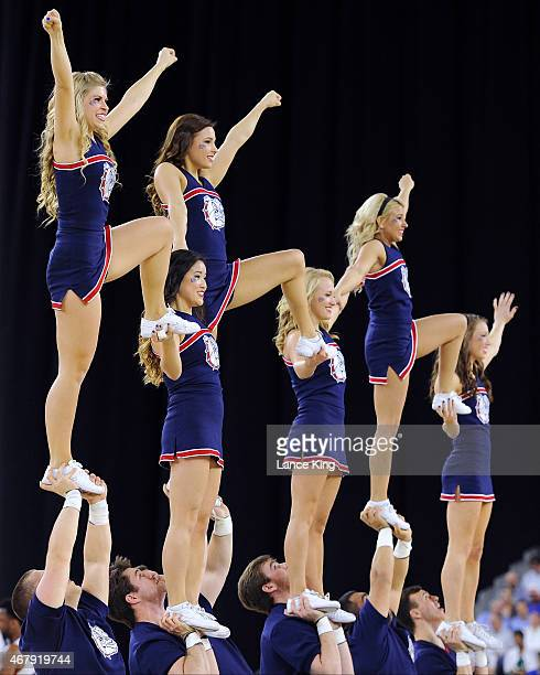 Cheerleaders of the Gonzaga Bulldogs perform against the UCLA Bruins during the South Regional Semifinal round of the 2015 NCAA Men's Basketball...