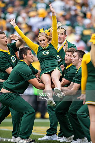 Cheerleaders of the Green Bay Packers perform during a game against the Washington Redskins at Lambeau Field on September 15 2013 in Green Bay...