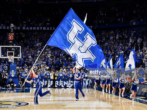 Cheerleaders of the Kentucky Wildcats run onto the court with flags prior to a game against the Texas A&M Aggies during the SEC Basketball Tournament...