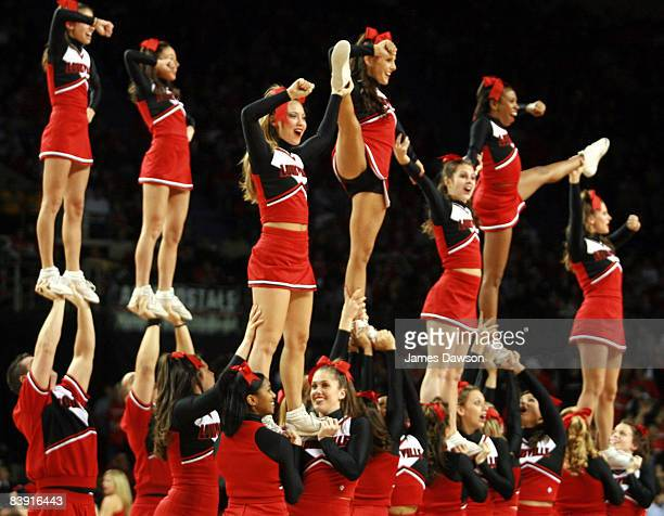 Cheerleaders of the Louisville Cardinals cheer for their team during a time out against the Syracuse Orangemen at Freedom Hall in Louisville Kentucky...