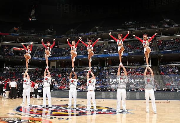 Cheerleaders of the Louisville Cardinals entertain the crowd against the Rutgers Scarlet Knights during the quarterfinal round of the American...