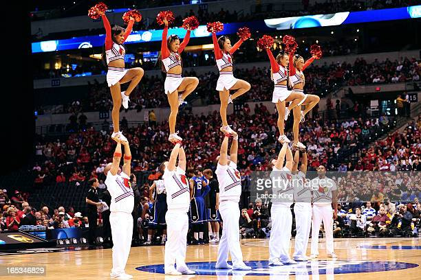 Cheerleaders of the Louisville Cardinals perform during a game against the Duke Blue Devils during the Midwest Regional Final of the 2013 NCAA Men's...