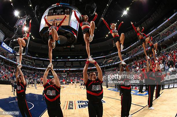 Cheerleaders of the Louisville Cardinals perform during a timeout against the Connecticut Huskies during the Championship of the American Athletic...