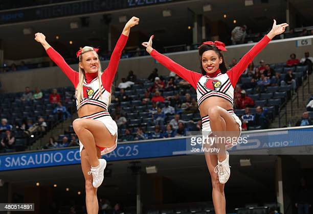 Cheerleaders of the Louisville Cardinals perform during a timeout against the Rutgers Scarlet Knights during the quarterfinal round of the American...