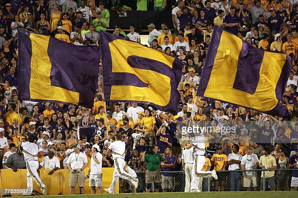 Cheerleaders of the LSU Tigers carries flags against the Florida Gators at Tiger Stadium on October 6 , 2007 in Baton Rouge, Louisiana. LSU defeated...