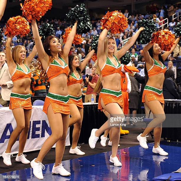 Cheerleaders of the Miami Hurricanes perform during a game against the North Carolina Tar Heels during the finals of the 2013 Men's ACC Tournament at...