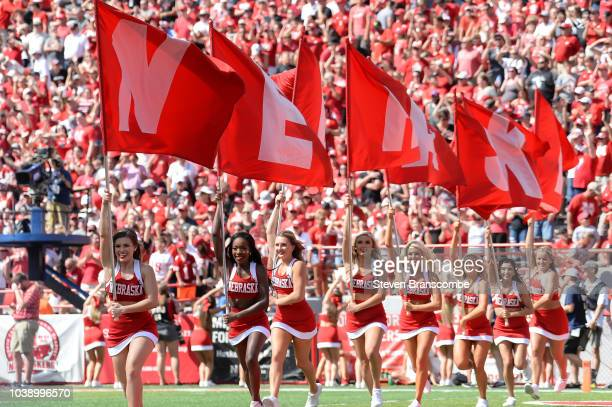 Cheerleaders of the Nebraska Cornhuskers celebrate a score against the Troy Trojans at Memorial Stadium on September 15 2018 in Lincoln Nebraska