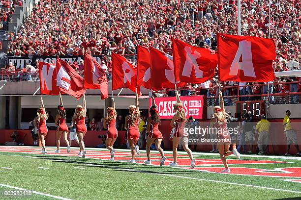 Cheerleaders of the Nebraska Cornhuskers celebrate a score against the Wyoming Cowboys at Memorial Stadium on September 10, 2016 in Lincoln,...